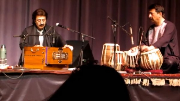 "Harmonium (that's the box with a keyboard and enclosed bellows): Khalil Ragheb  Tula (flutelike instrument): Pervez Sakhi  A ghazal is a ""a poetic expression of both the pain of loss or separation and the beauty of love in spite of that pain."" (Wikipedia) It originated in Sufi mysticism--the aspect of Islam that Islamic fundamentalists most despise. This is the kind of music that the Taliban banned during its reign in Afghanistan. Tabla (pair of tuned drums side by side): Ezmarai Aref Doyra (single drum): Abbos Kosimov (from Uzbekistan; all the others are from Afghanistan)  This music is very closely related to Indian music, both in style and in instrumentation.  The group, called the Sakhi Ensemble, had CDs you can buy, and Kosimov has his own CD as well (he also performs with the group Masters of Percussion)."